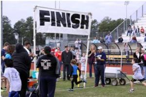 Helene Farris of San Antonio as she wins the K-2 1K at the 2012 Jr. Tiger Fun Run